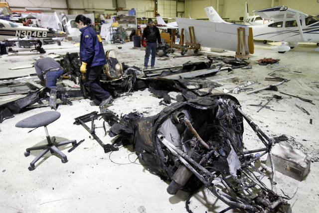 The National Transportation Safety Board conducts an initial aircraft layout examination of the wreckage of a Lancair experimental aircraft that crashed on Friday, inside a hangar at the Boise Airport on Saturday Feb. 4, 2012, in Boise, Idaho. The crash killed both the pilot and Micron CEO Steve Appleton.  Appleton, who had a reputation as a hard-driving daredevil, was known for takings risks in stunt piloting and he survived a similar crash eight years earlier. Micron colleagues said that same energy and drive helped establish the Idaho company's place on the world stage as one of the leaders in memory-chip production. (AP Photo/The Idaho Statesman, Joe Jaszewski, Pool)  MANDATORY CREDIT