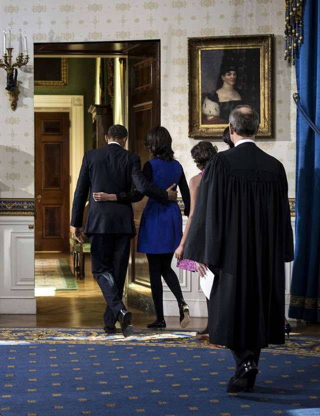 President Barack Obama walks with his daughter Malia as first lady Michelle Obama and daughter Sasha and Chief Justice John Roberts as they leave the Blue Room after being oficially sworn-in by Chief Justice John Roberts, back in the Blue Room of the White House during the 57th Presidential Inauguration in Washington, Sunday, Jan. 20, 2013. (AP Photo/Brendan Smialowsi, Pool) ORG XMIT: WX411