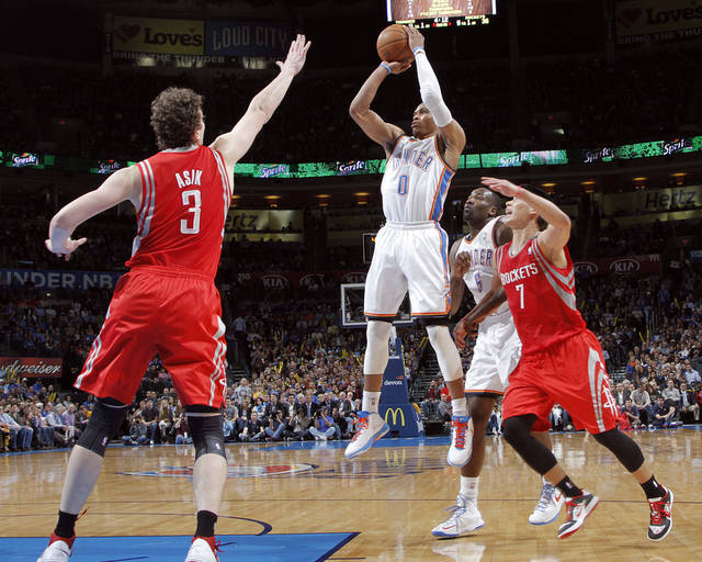 Oklahoma City 's Russell Westbrook (0) shoots over Houston's Omer Asik (3) and Jeremy Lin (7) during the NBA basketball game between the Houston Rockets and the Oklahoma City Thunder at the Chesapeake Energy Arena on Wednesday, Nov. 28, 2012, in Oklahoma City, Okla.   Photo by Chris Landsberger, The Oklahoman