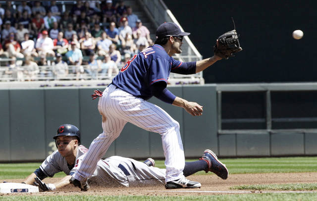 Cleveland Indians' Michael Brantley slides safely into third for a triple as Minnesota Twins' Jamey Carroll waits for the throw in the fourth inning of a baseball game Tuesday, May 15, 2012, in Minneapolis. (AP Photo/Jim Mone)