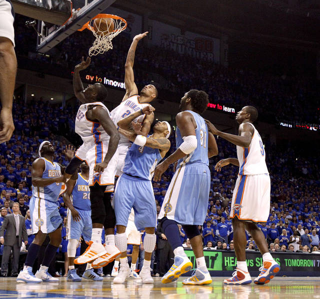 Oklahoma City's Kendrick Perkins (5) and Thabo Sefolosha (2) tip the ball in in front of Denver's Kenyon Martin (4) and Nene (31) in the final minutes of the NBA basketball game between the Denver Nuggets and the Oklahoma City Thunder in the first round of the NBA playoffs at the Oklahoma City Arena, Sunday, April 17, 2011. Photo by Bryan Terry, The Oklahoman