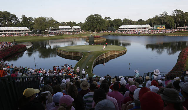 Tiger Woods (red shirt), center, and Casey Wittenberg play the 17th hole during the final round of The Players championship golf tournament at TPC Sawgrass, Sunday, May 12, 2013, in Ponte Vedra Beach, Fla.  (AP Photo/Gerald Herbert)