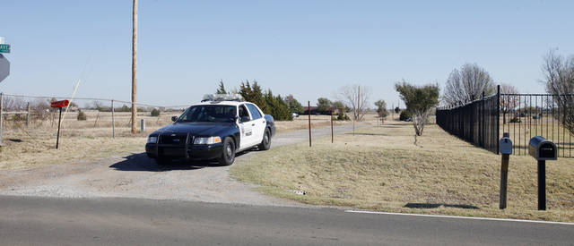 Police blocking the drive to keep people out of a house in the 11000 block of S Bryant where a standoff and homicide occurred in Oklahoma City Wednesday, Nov 14, 2012. Photo by Paul B. Southerland, The Oklahoman