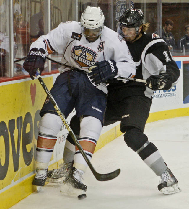 Shawn Belle of the Oklahoma CIty Barons and Ryan Weston of the San Antonio Rampage battle for the puck during an AHL hockey game at the Cox Convention Center in Oklahoma City, Tuesday, Nov. 9, 2010.  Photo by Bryan Terry, The Oklahoman ORG XMIT: KOD