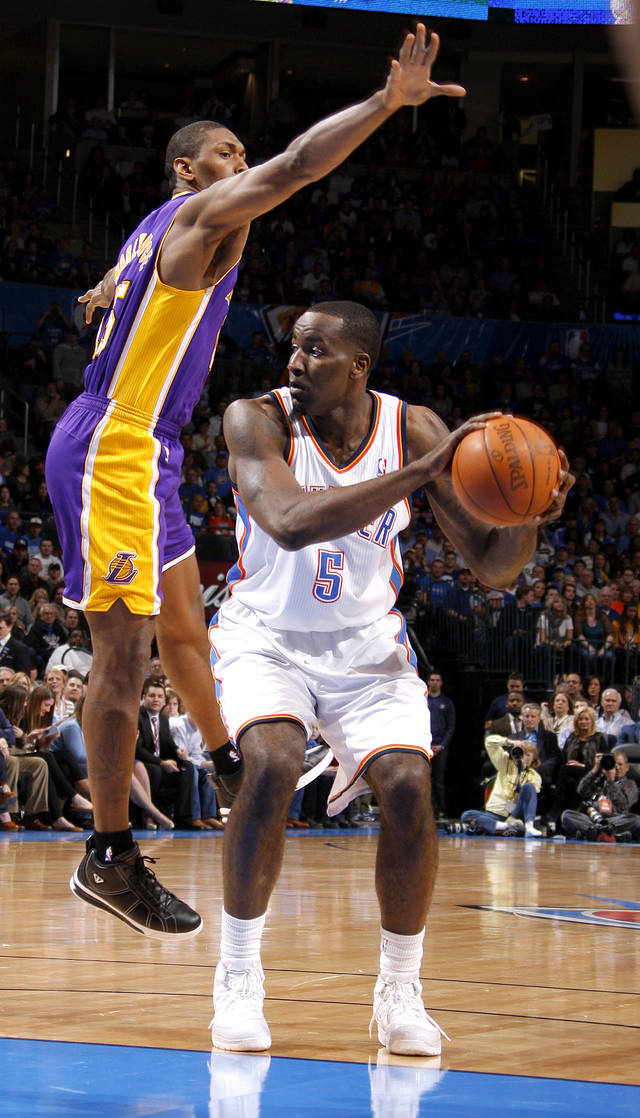 Oklahoma City's Kendrick Perkins (5) looks to pass the ball beside Los Angeles' Metta World Peace (15) during an NBA basketball game between the Oklahoma City Thunder and the Los Angeles Lakers at Chesapeake Energy Arena in Oklahoma City, Thursday, Feb. 23, 2012. Photo by Bryan Terry, The Oklahoman