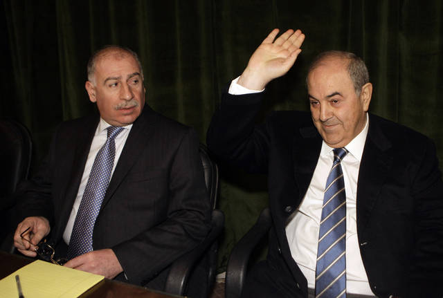 FILE - In this Jan. 18, 2012 file photo, Ayad Allawi, the leader of Iraq's main Sunni-backed bloc and former prime minister, right, gestures as Iraq's Parliament Speaker Osama al-Nujaifi looks on during a meeting of their bloc in Baghdad, Iraq. An official from the bloc said its ministers have ended their boycott of the Cabinet Tuesday, Feb. 7, 2012, a move that could restore some stability to the war-ravaged nation. (AP Photo/Khalid Mohammed, File)