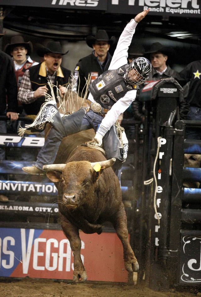 Cord McCoy rides Ragin JT during the Winstar World Casino Invitational PBR event at the Chesapeake Energy Arena in Oklahoma City, Friday, Feb. 10, 2012. Photo by Sarah Phipps, The Oklahoman