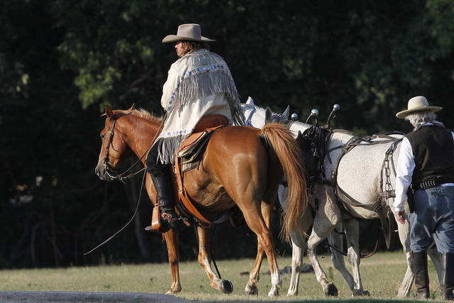 Kevin Webb as Pawnee Bill, leads horses to the staging area before the start of the Pawnee Bill Wild West Show in Pawnee, Oklahoma on Saturday,  June 23, 2012.  Photo by Jim Beckel, The Oklahoman