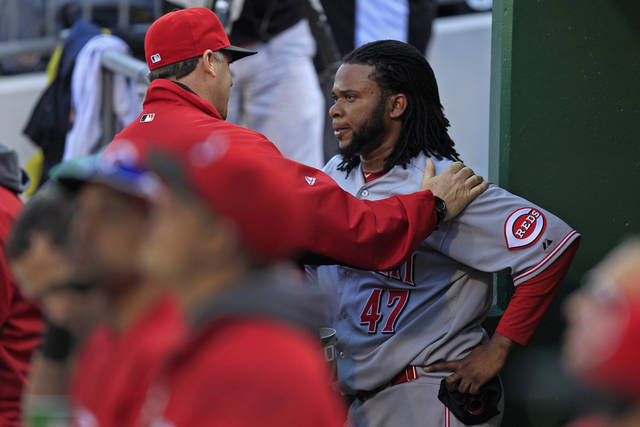 Cincinnati Reds starting pitcher Johnny Cueto (47) listens to Cincinnati Reds pitching coach Bryan Price, left, after being pulled from the game after pitching the seventh inning of a baseball game against the Pittsburgh Pirates in Pittsburgh Sunday, Sept. 30, 2012. The Reds won 4-3, with Cuerto not figuring in the decision. (AP Photo/Gene J. Puskar)