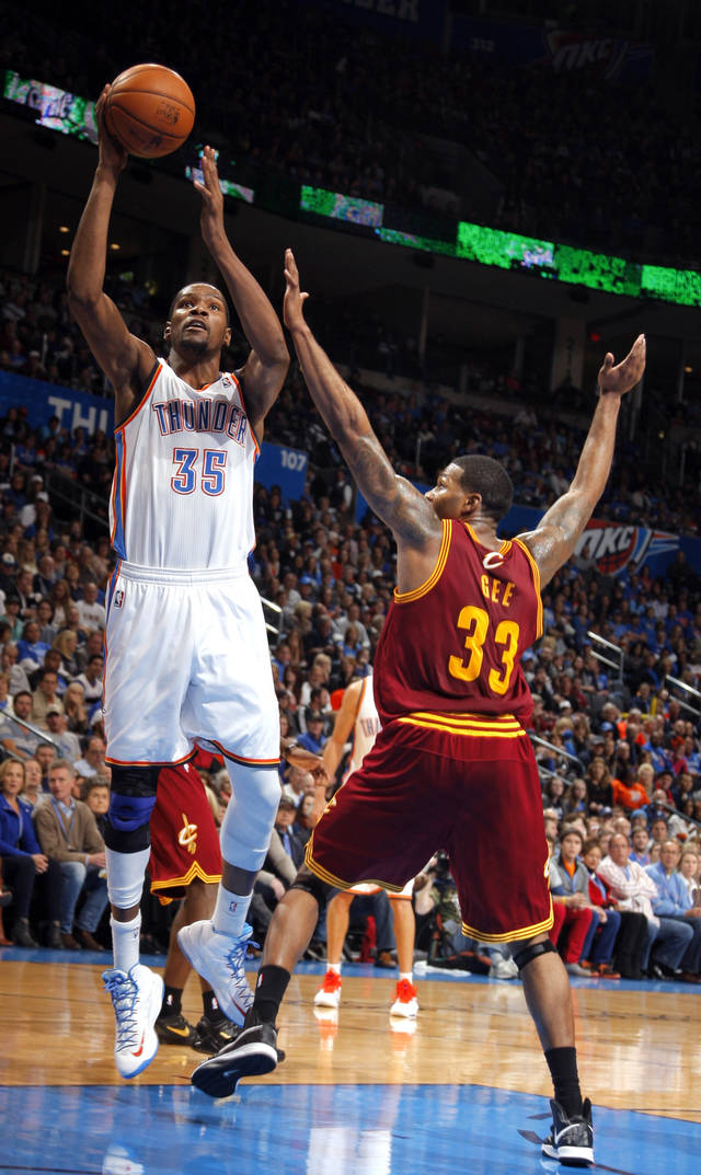 Oklahoma City's Kevin Durant (35) shoots as Cleveland's Alonzo Gee (33) defends during the NBA basketball game between the Oklahoma City Thunder and the Cleveland Cavaliers at the Chesapeake Energy Arena, Sunday, Nov. 11, 2012. Photo by Sarah Phipps, The Oklahoman