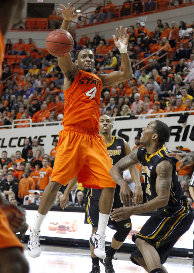 Oklahoma State's Brian Williams (4) defends Missouri's Marcus Denmon (12) during an NCAA college basketball game between the Oklahoma State University Cowboys (OSU) and the Missouri Tigers (MU) at Gallagher-Iba Arena in Stillwater, Okla., Wednesday, Jan. 25, 2012. Oklahoma State won 79-72.  Photo by Bryan Terry, The Oklahoman