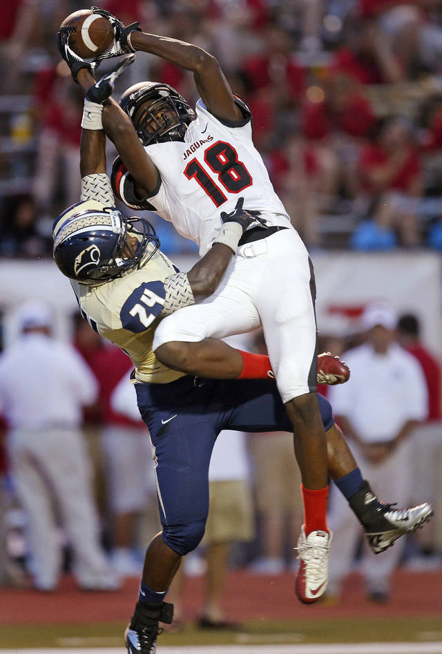 Westmoore's Dahu Green catches the ball over Southmoore's Reginald Dantzler Jr.  during their high school football game in Moore, Okla., Friday, Sept. 13, 2013. Photo by Bryan Terry, The Oklahoman