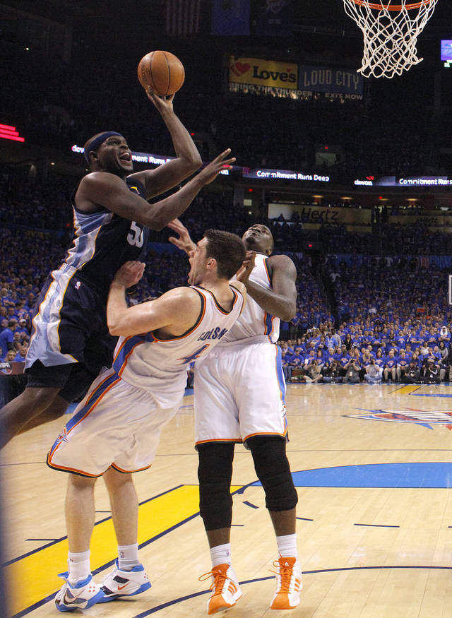 Oklahoma City's Nick Collison (4) draws a charge call on Zach Randolph (50) of Memphis as Oklahoma City's Kendrick Perkins (5) looks on during game 7 of the NBA basketball Western Conference semifinals between the Memphis Grizzlies and the Oklahoma City Thunder at the OKC Arena in Oklahoma City, Sunday, May 15, 2011. Photo by Sarah Phipps, The Oklahoman