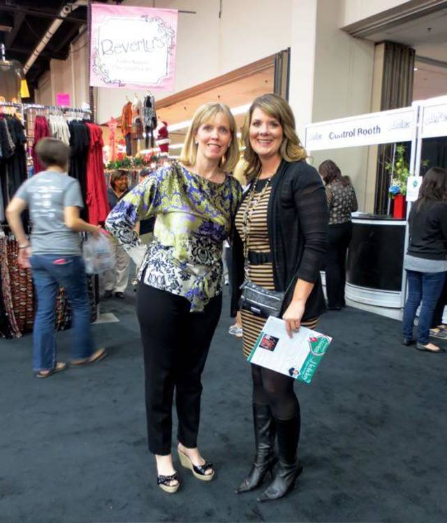 Cristi Reiger and Becky Howell enjoy the Junior League's Mistletoe Market at the Cox Convention Center. (Photo by Helen Ford Wallace).