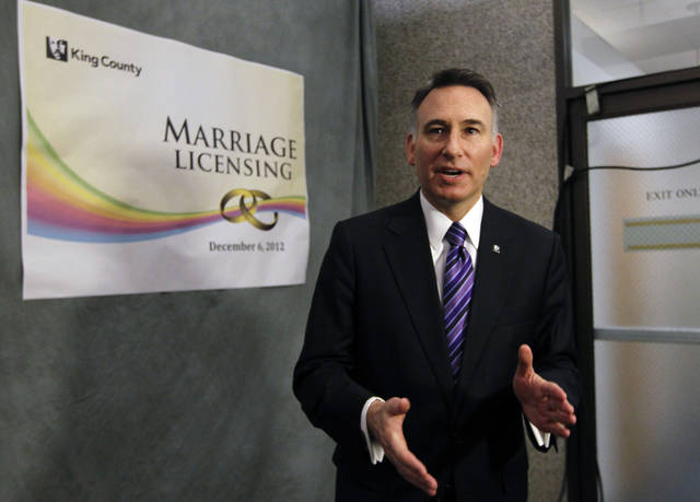 King County Executive Dow Constantine speaks to reporters on Wednesday, Dec. 5, 2012, about issuing marriage licenses to same-sex couples just after midnight in Seattle. Constantine was to begin issuing the licenses immediately upon certification of the November election that passed Referendum 74. (AP Photo/Elaine Thompson)