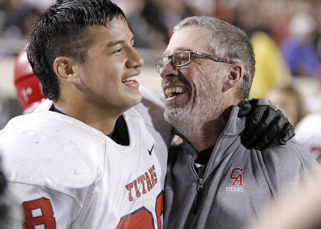 Carl Albert's Robert Lolofie (68) celebrates with coach Gary Rose during the Class 5A Oklahoma state championship football game between Carl Albert High School and Tulsa East Central High School at Boone Pickens Stadium on Saturday, Dec. 1, 2012, in Stillwater, Okla.   Photo by Chris Landsberger, The Oklahoman
