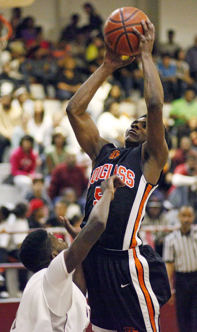 Douglass High School basketball player Stephen Clark, shown here during a February 2012 game in Oklahoma City, committed to play college basketball at Oklahoma State on Friday. PHOTO BY NATE BILLINGS, The Oklahoman Archive <strong>NATE BILLINGS</strong>