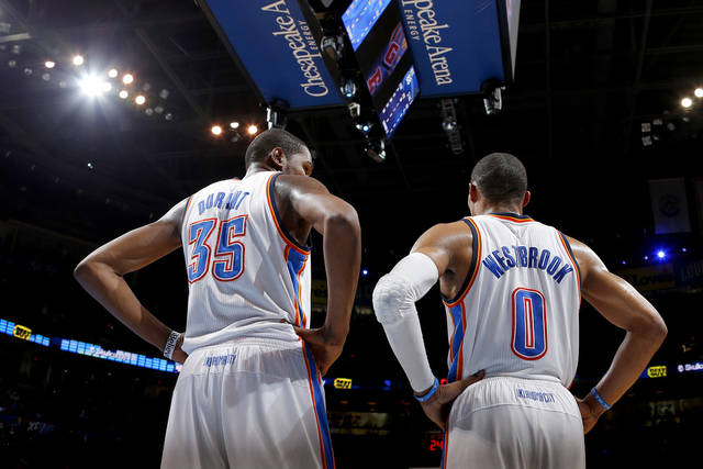 Oklahoma City's Kevin Durant (35) talks with Russell Westbrook (0) during an NBA basketball game between the Oklahoma City Thunder and the Miami Heat at Chesapeake Energy Arena in Oklahoma City, Thursday, Feb. 15, 2013. Miami won 110-100. Photo by Bryan Terry, The Oklahoman