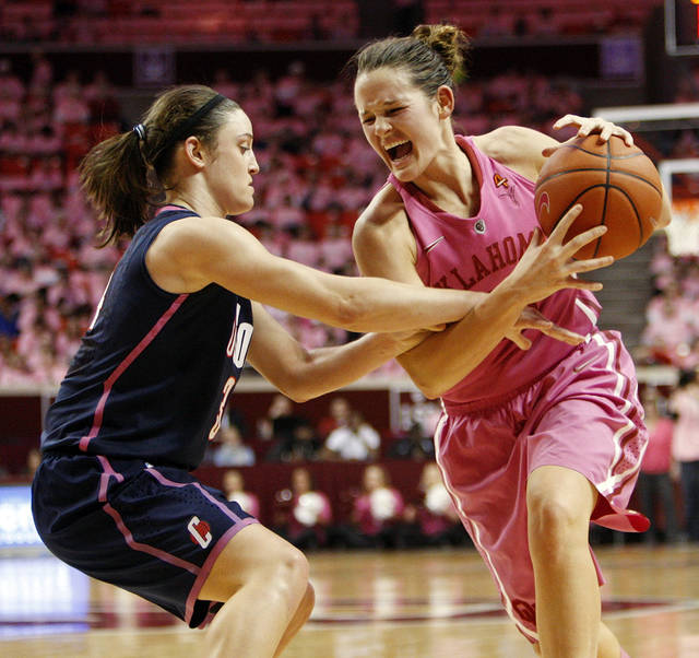 Kelly Faris (34) of UConn pressures Whitney Hand (25) of OU in the first half of a women's college basketball game between the University of Oklahoma Sooners and the University of Connecticut Huskies at the Lloyd Noble Center in Norman, Okla., Monday, Feb. 13, 2012. Photo by Nate Billings, The Oklahoman