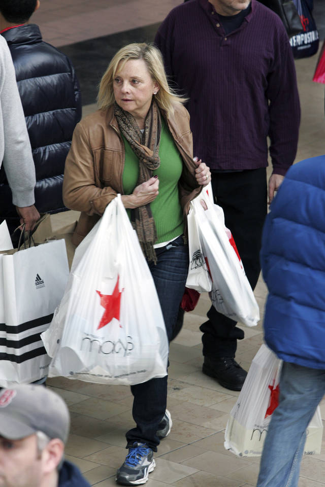 Last-minute Christmas shoppers crowd the Willowbrook Mall searching for gifts, Sunday, Dec. 23, 2012, in Wayne, N.J. This holiday season, Americans have a lot on their minds on top of the now familiar job worries. (AP Photo/The Record (Bergen County NJ), Chris Pedota) ONLINE OUT; MAGS OUT; TV OUT; INTERNET OUT; NO ARCHIVING; MANDATORY CREDIT.