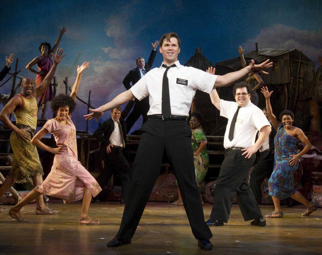 "FILE - In this file theater publicity image provided by Boneau/Bryan-Brown, Andrew Rannells, center, performs with an ensemble cast in ""The Book of Mormon"" at the Eugene O'Neill Theatre in New York. Most Broadway shows had a lot to be thankful for this Thanksgiving; box offices jumped more than $6 million from the previous week. Some of the biggest winners were �The Book of Mormon� and �Annie,� which both set house records. (AP Photo/Boneau/Bryan-Brown, Joan Marcus, File)"