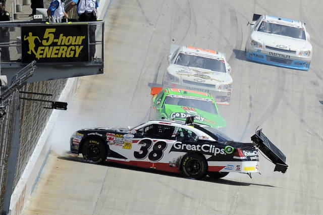 Driver Brad Sweet (38) and Danica Patrick, middle, crash along the front straightaway during the NASCAR Nationwide Series auto race, Saturday, June 2, 2012, in Dover, Del. (AP Photo/Nick Wass)