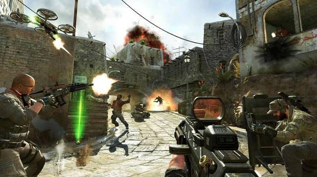 """This undated publicity image released by Activision shows soldiers and terrorists battling in the streets of Yemen in a scene from the video game, """"Call of Duty: Black Ops II.""""  Video-game violence has come under increased scrutiny after the killing of 26 people, including 20 children, in a Connecticut elementary school last week. (AP Photo/Activision)"""