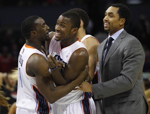 Charlotte Bobcats' Ben Gordon, left, celebrates with teammates Michael Kidd-Gilchrist, center, and Gerald Henderson, right, after their 98-97 win over the Toronto Raptors in an NBA basketball game in Charlotte, N.C., Wednesday, Nov. 21, 2012. (AP Photo/Chuck Burton)