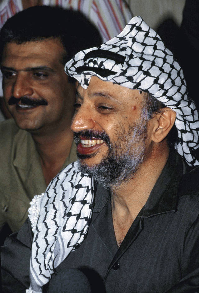 FILE - This photo shows Yasser Arafat, PLO leader shown smiling, taken in Beirut, Lebanon, in an August 1981 file photo. A Palestinian official says the remains of former Palestinian leader Yasser Arafat will be exhumed on Tuesday Nov. 27, 2012 to enable foreign experts to take samples as part of a probe into his death. (AP Photo/ Zuheir Saade, File)
