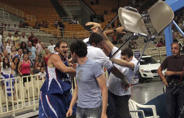 Nenad Krstic threw a chair during a brawl on Thursday in Athens.  AP PHOTO