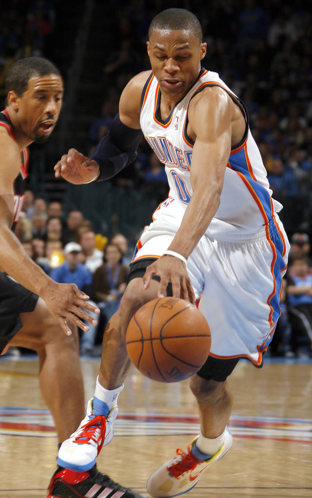 Oklahoma City's Russell Westbrook (0)grabs a loose ball in front of Portland's Andre Miller (24) during the NBA game between the Oklahoma City Thunder and the Portland Trailblazers, Sunday, March 27, 2011, at the Oklahoma City Arena. Photo by Sarah Phipps, The Oklahoman