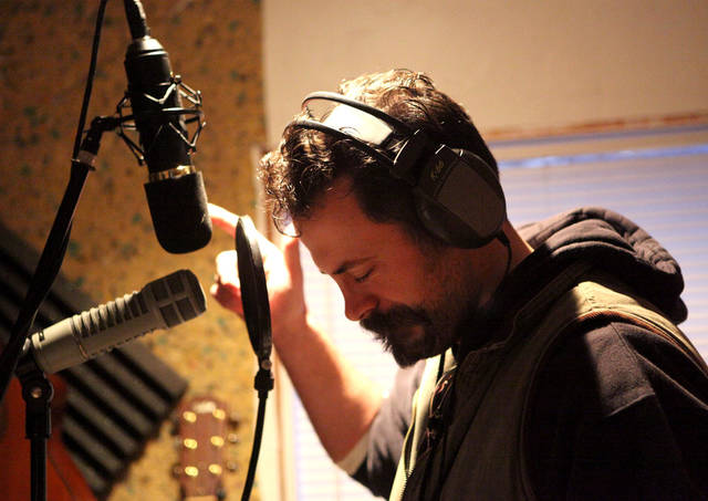 Matt Bowlin listens to a playback while recording a new CD  at The Dirty Bird Recording Studio outside Oklahoma City on Monday, Feb. 2, 2009. By John Clanton, The Oklahoman