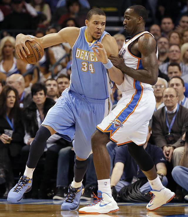 Oklahoma City's Kendrick Perkins (5) defends on Denver's JaVale McGee (34) during the NBA basketball game between the Oklahoma City Thunder and the Denver Nuggets at the Chesapeake Energy Arena on Wednesday, Jan. 16, 2013, in Oklahoma City, Okla.  Photo by Chris Landsberger, The Oklahoman