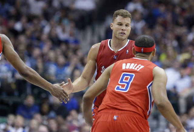 Los Angeles Clippers forward Blake Griffin is congratulated by a teammate after he scored in the second half of an NBA basketball game against the Dallas Mavericks on Thursday, March 27, 2014, in Dallas. The Clippers won 109-103. (AP Photo/LM Otero)
