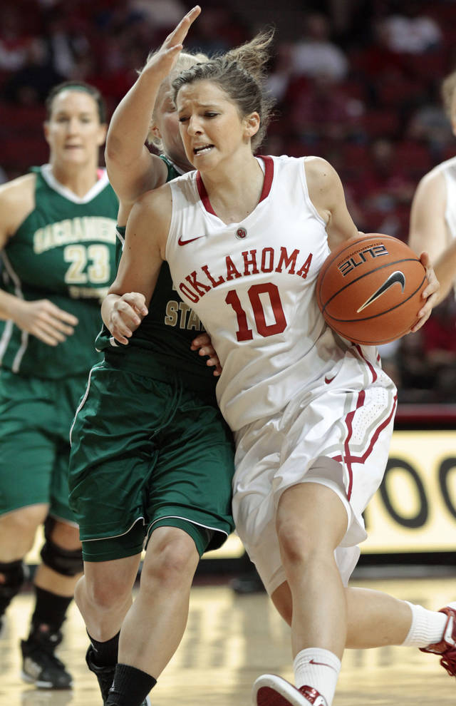 OU WOMEN'S COLLEGE BASKETBALL: Oklahoma Sooners' Morgan Hook (10) tries to get past Sacramento State Hornets' Alle Moreno (22) as the University of Oklahoma Sooner women's basketball team plays the Sacramento State Hornets at the Lloyd Noble Center on Sunday, Nov. 13, 2011, in Norman, Okla.  Photo by Steve Sisney, The Oklahoman ORG XMIT: KOD