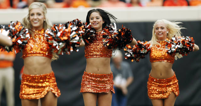 Members of the OSU pom squad dance during a college football game between Oklahoma State University (OSU) and the University of Louisiana-Lafayette (ULL) at Boone Pickens Stadium in Stillwater, Okla., Saturday, Sept. 15, 2012. OSU won, 65-24. Photo by Nate Billings, The Oklahoman