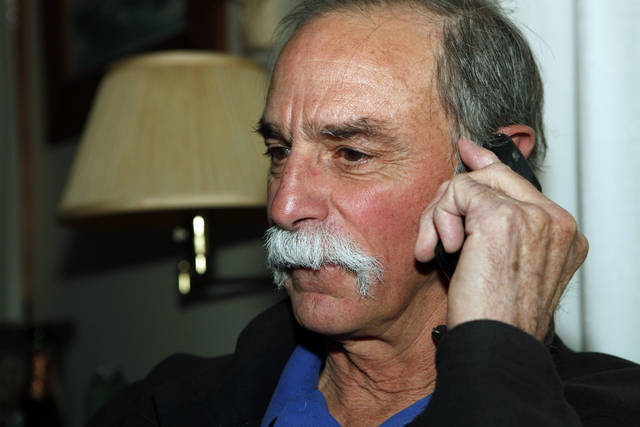 David Wineland, an American physicist at the National Institute of Standards in Boulder who shares the 2012 Nobel Prize in Physics with Serge Haroche, talks on the phone about his prize at his home in Boulder, Colo., on Tuesday, Oct. 9, 2012. (AP Photo/Ed Andrieski)