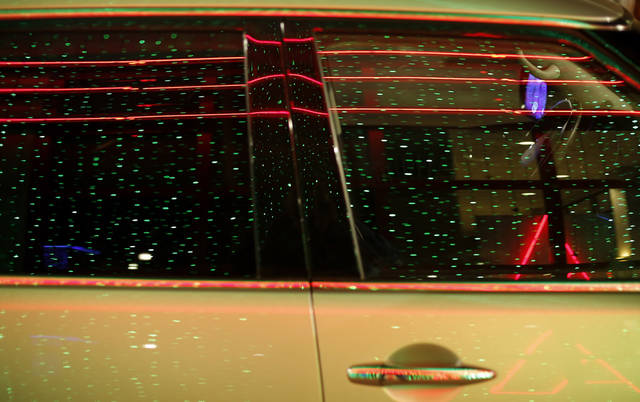 Christmas lights along Broadway reflect on a vehicle in the area called Automobile Alley Tuesday, December 4, 2012. Photo by Doug Hoke, The Oklahoman
