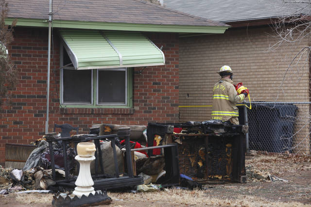 An Oklahoma City firefighter works at the scene of the fatal house fire near NE 29 and Martin Luther King Avenue.