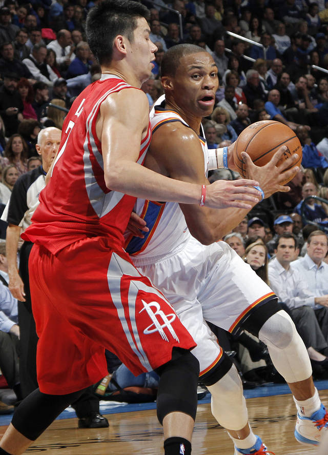 Oklahoma City 's Russell Westbrook (0) drives past Houston's Jeremy Lin (7) during the NBA basketball game between the Houston Rockets and the Oklahoma City Thunder at the Chesapeake Energy Arena on Wednesday, Nov. 28, 2012, in Oklahoma City, Okla.   Photo by Chris Landsberger, The Oklahoman