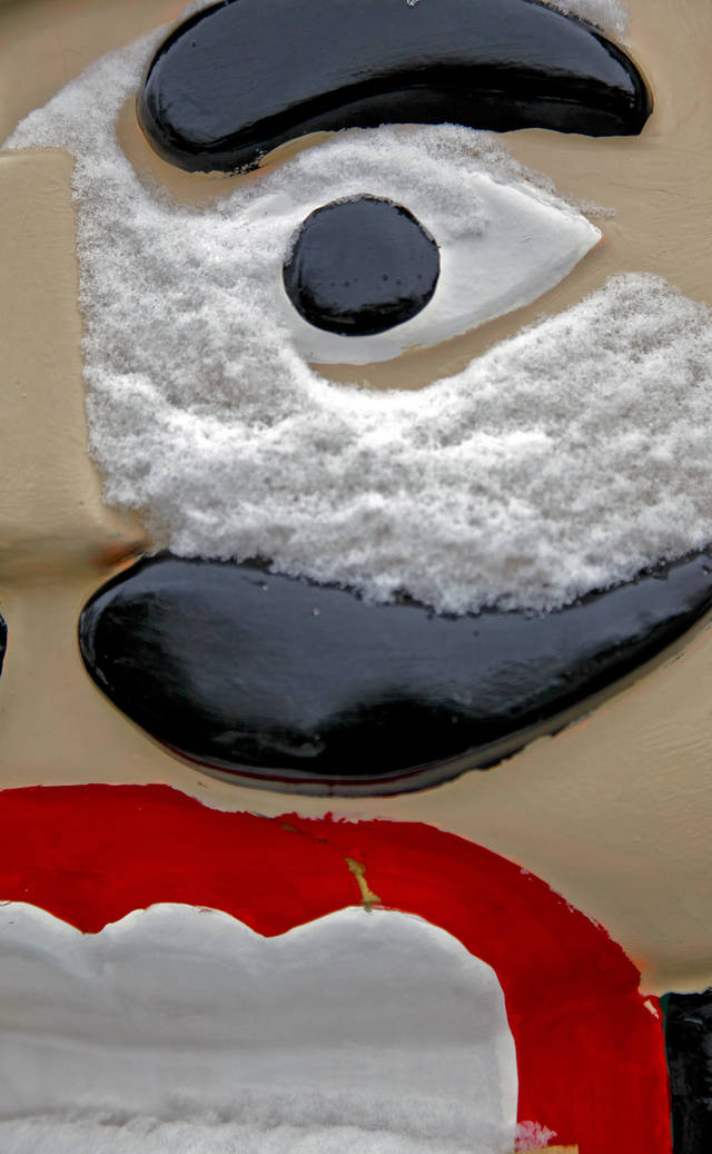 COLD / WINTER WEATHER: Snow collects on the face of a Nutcracker soldier at Chisholm Trail Park on Friday, Dec. 28, 2012, in Yukon, Okla.  Photo by Chris Landsberger, The Oklahoman