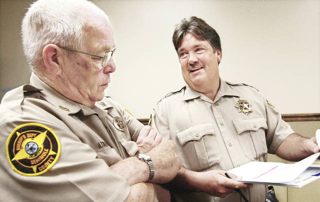 Seminole County Sheriff Shannon Smith, right, talks to Deputy Kenneth Sallee in the sheriff's office at the Seminole County Courthouse. On Monday county leaders replaced Sheriff Joe Craig because his certification was suspended. PHOTO BY JIM BECKEL,  THE OKLAHOMAN