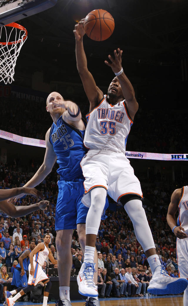 Oklahoma City's Kevin Durant (35) goes for a rebound in front of Dallas' Chris Kaman (35) during an NBA basketball game between the Oklahoma City Thunder and the Dallas Mavericks at Chesapeake Energy Arena in Oklahoma City, Thursday, Dec. 27, 2012.  Oklahoma City won 111-105. Photo by Bryan Terry, The Oklahoman