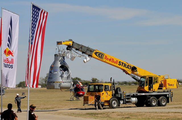 The ascension capsule is moved behind Mission Control after Felix Baumgartner's 23-mile-high jump was aborted, Tuesday, Oct. 9, 2012, in Roswell, NM. Baumgartner was attempting to break the speed of sound with his own body by jumping from the capsule lifted by a 30 million cubic foot helium balloon. (AP Photo/Matt York)