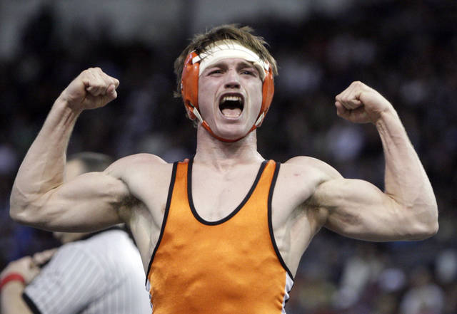 Pawhuska's Cameron Kirk celebrates his win over Trent Williams in the Class 3A 145-pound match during the state wrestling championships at the State Fair Arena in Oklahoma City, Saturday, Feb. 25, 2012. Photo by Sarah Phipps, The Oklahoman