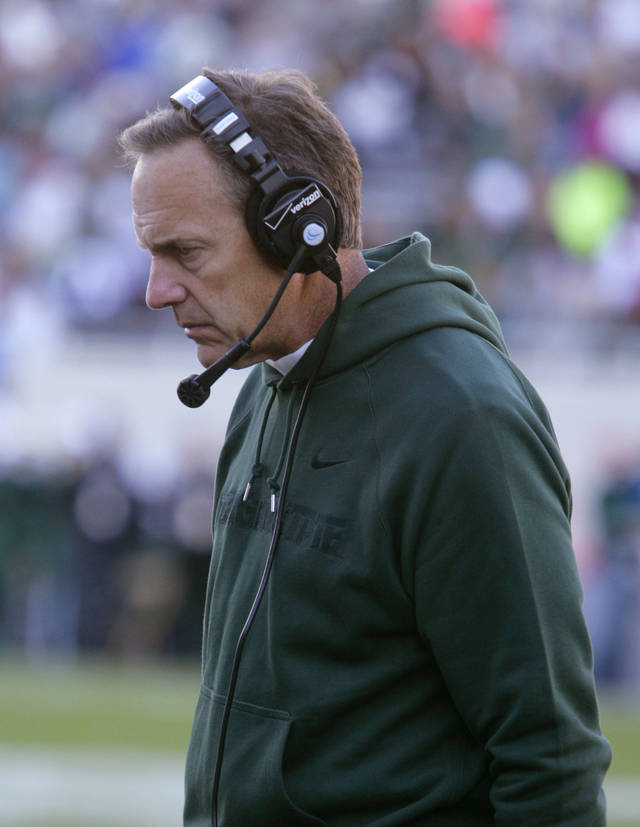 Michigan State coach Mark Dantonio walks the sideline during the third quarter of an NCAA college football game against Eastern Michigan, Saturday, Sept. 22, 2012, in East Lansing, Mich. Michigan State won 23-7. (AP Photo/Al Goldis)
