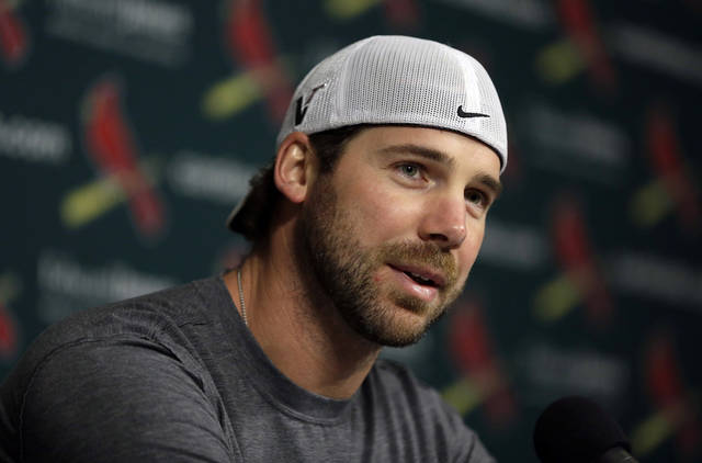 FILE - In this Feb. 11, 2013, file photo, St. Louis Cardinals pitcher Chris Carpenter speaks about his future during a baseball news conference in St. Louis. Carpenter realizes his baseball career may be over. The 37-year-old right-hander made a surprise appearance at the team's spring-training camp Monday, March 18, and said he is still dealing with numbing and tingling sensations in his pitching hand, arm and shoulder. (AP Photo/Jeff Roberson, File)