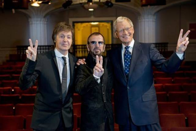 "In this Feb. 4, 2014 photo provided by CBS, surviving Beatles Paul McCartney, left and Ringo Starr, center, pose for a photo with talk show host David Letterman in the Ed Sullivan Theater, in New York. Letterman'�s special interview with them was featured in ""�The Beatles: The Night That Changed America - A Grammy Salute."""