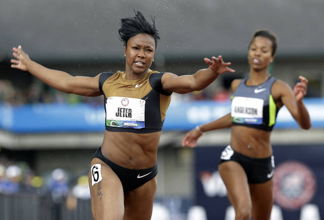 Carmelita Jeter reacts after winning the women's 100m final at the U.S. Olympic Track and Field Trials Saturday, June 23, 2012, in Eugene, Ore. (AP Photo/Eric Gay)