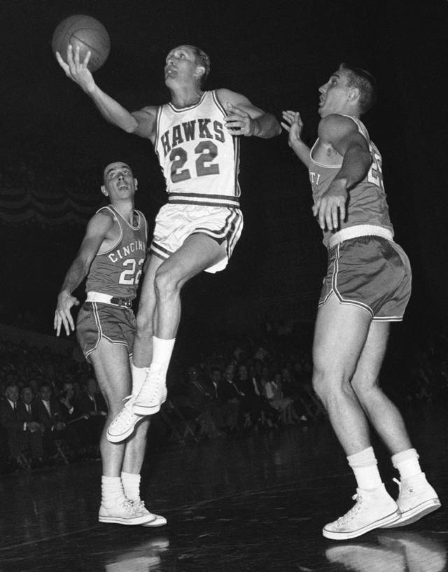 FILE - In this Oct. 31, 1959, file photo, St. Louis Hawks' Slater Martin (22) leaps to make a basket in the first period of an NBA basketball game against the Cincinnati Royals in St, Louis. Martin, the Hall of Fame guard who won four NBA titles with the Minneapolis Lakers and one with the St. Louis, died Thursday, Oct. 18, 2012. He was 86. (AP Photo/File)